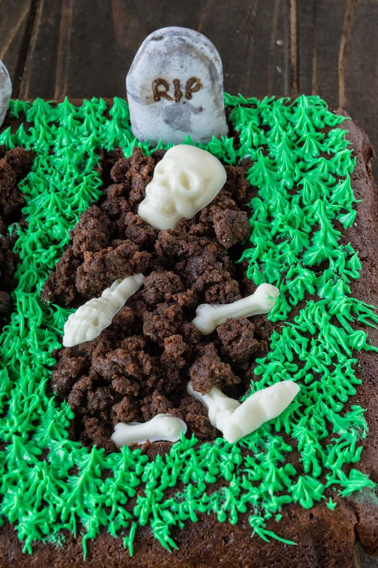 Halloween brownie graveyard. A giant brownie with grass frosting and white chocolate skeletons.