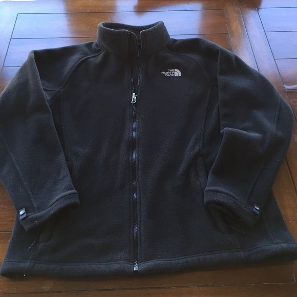 NORTH FACE ladies jacket. Black. XL This North Face fleece jacket was worn only a few times. In EUC. Black fully zips to a mock turtleneck style with zip pockets and snaps at wrists. Black. XL North Face Jackets & Coats