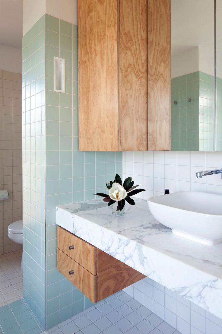 Bathroom vanities that are practical and so pretty. Photography by Jon Linkins.