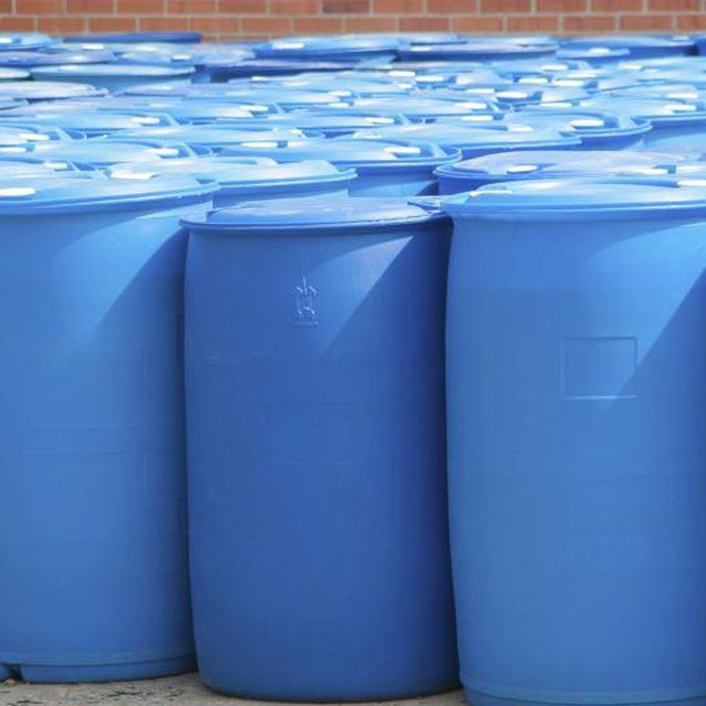 55-gallon plastic barrels outside a building