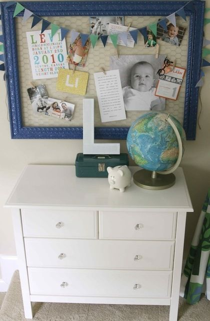 chicken wire picture frame.  maybe don't want to use chicken wire, but love the painted picture frame as a bulletin board idea.