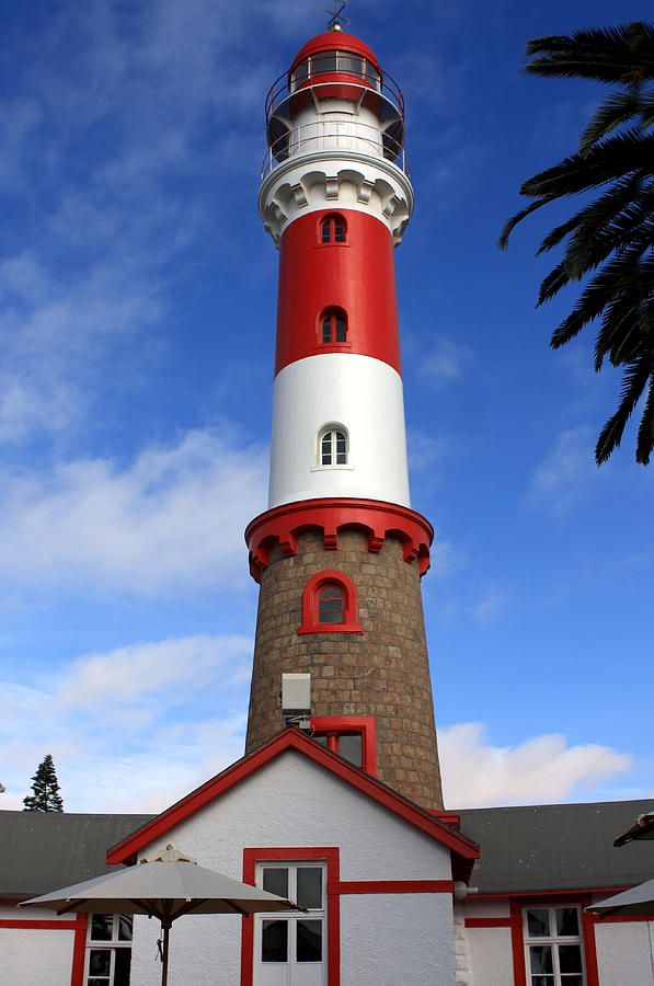 Swakopmund Lighthouse was opened in July 1902. The Lighthouse is still in operation, guiding ships with its light seen as far as from 35 nautical miles. One of the most prominent Swakopmund's landmarks, now also houses a restaurant. The lantern of the present light was installed in 1982 along with a more powerful light having a range of 20 miles. The restaurant use to be the keepers' accommodation. It's light was automated in 1956. Location Namibia.