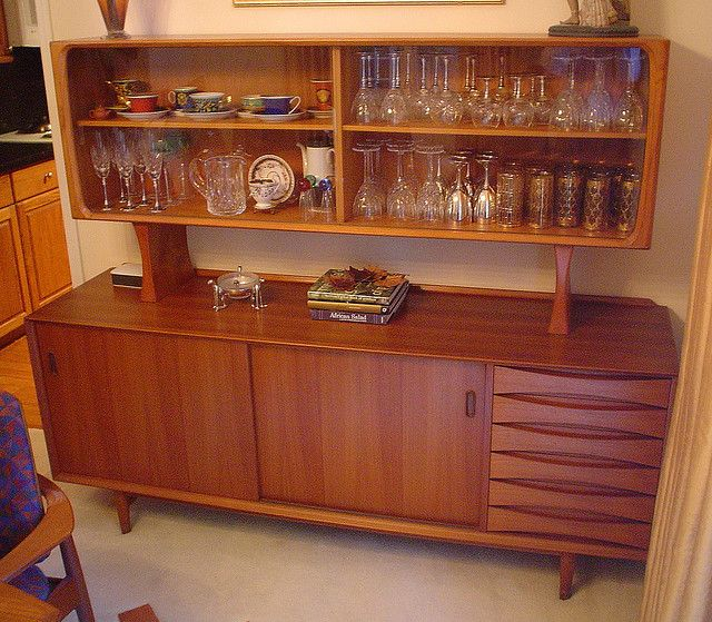 yes! 5 ft of danish modern furniture, designate solely to the storage of alcoholic beverages and drinking apparatuses, is completely necessary.