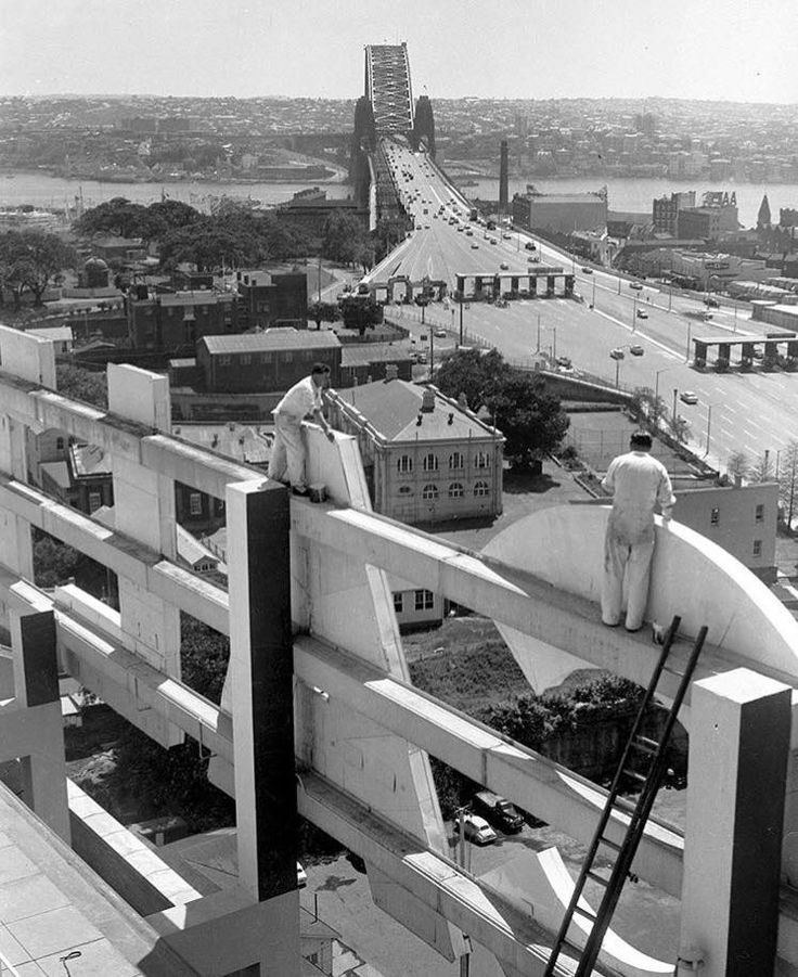 Workmen painting the Caltex sign on Caltex House on Kent Street at Millers Point in October of 1959. At the time of its completion it was the tallest building in Australia and the first all concrete building, it has since been converted to residential units. Source: Fairfax Archives (Photo by Vic Wright)