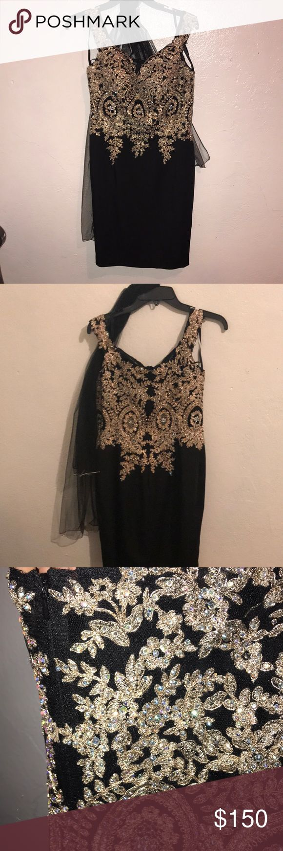 semi-formal dress black with gold details , midi length, kind of skin tight . only worn once , like new , off the shoulder! Dresses Prom