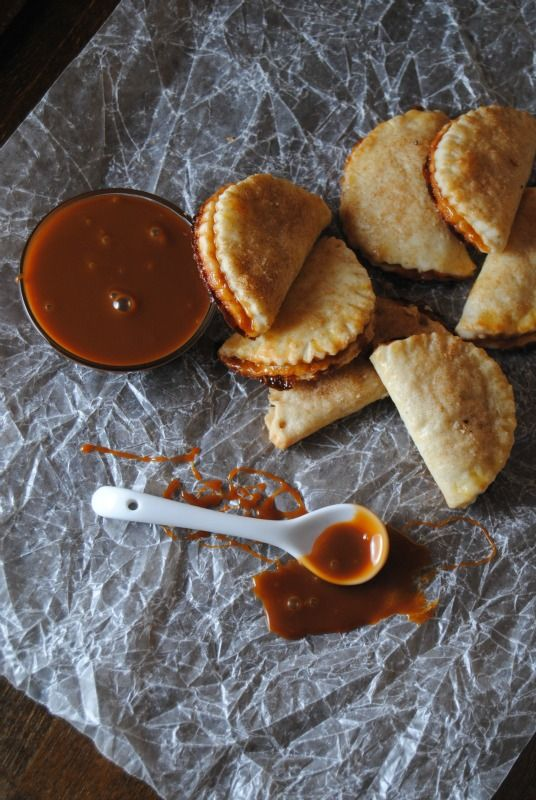 These caramel empanadas are so simple, but absolutely decadent! Made with an easy cream cheese dough and store-bought caramel sauce
