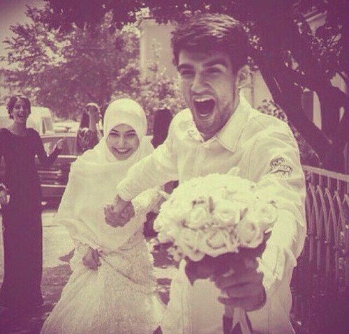 in love with this picture! So adorable- love the groom's expression- they're so happy!!