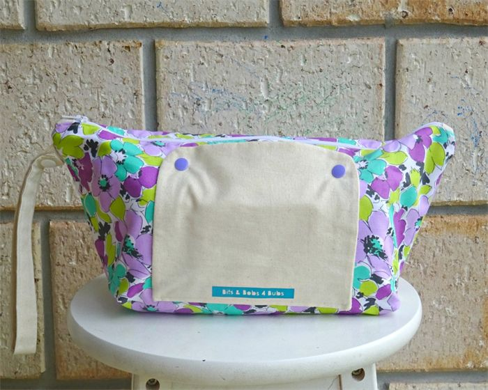 nappy wallet that can carry 80 pack of wipes that is accessible from the outside, nappy sacks and disposable nappys