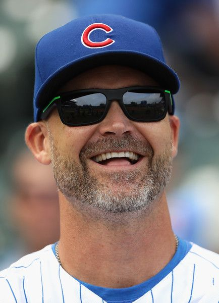 David Ross #3 of the Chicago Cubs, who is retiring after the season, smiles as he watches a video tribute of his career before a game against the St. Louis Cardinals at Wrigley Field on September 23, 2016 in Chicago, Illinois.
