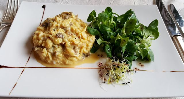 Creamy scrambled eggs with girolles mushrooms and a Mâche salad