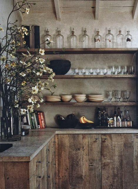 rustic wood, shelving, exposed dishes.. love