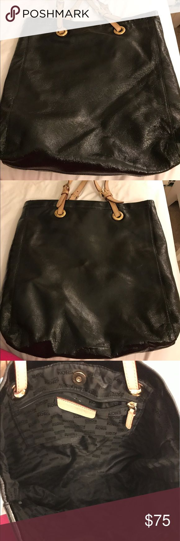 Michael Kors Jet Set Signature Tote Black glossy tote bag, used. In good condition. Straps show signs of wear. MK bangle fell off. Michael Kors Bags Totes