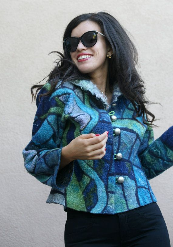 FELTING * FELTED JACKET * ECO FASHION * MOSAIC BLUE JACKET * FELTED CLOTHES * This is one of a kind handmade Nuno felted very bright and fun jacket. The lining is made out of natural cotton and the collar is made with natural sheep locks (eco fur). The jacket is inlaid with various shades of blue and green pieces of wool decorated with silk fibers, which are arranged in an intricate pattern. This jacket is very lightweight, yet very warm. Its very comfortable to wear - its very soft, very…