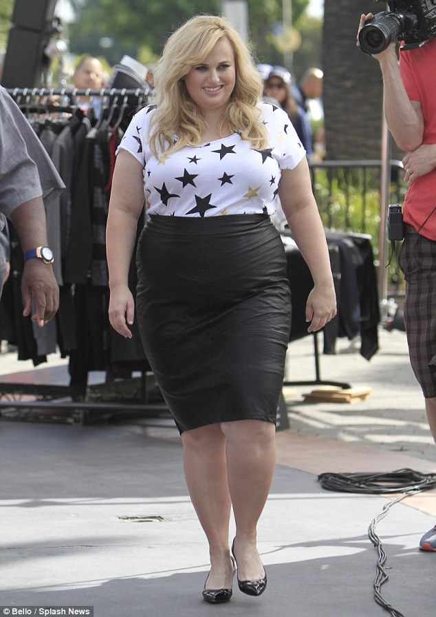 Working it: Rebel was dressed in a white T-shirt and high-waisted leather look skirt both from her new plus-size range