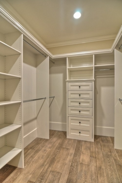 Nice and simple walk-in closet with shelves, drawers, and rods. A large ottoman could be used as an island.