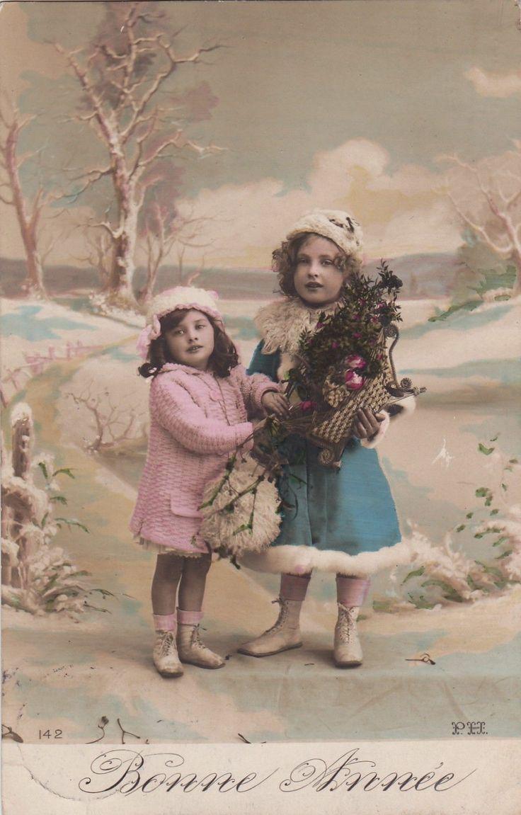 Beautiful Edwardian Girls In Snowy Winter Landscape