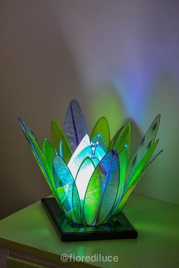 A modern and delicate lamp, or two coupled for your bedside tables,  elegant and discreet, a little masculine and linear are made in a soft green tone  obtained with photos of succulents and yellow, blue and green solid colors,  create an energetic environment using warm or more relaxed