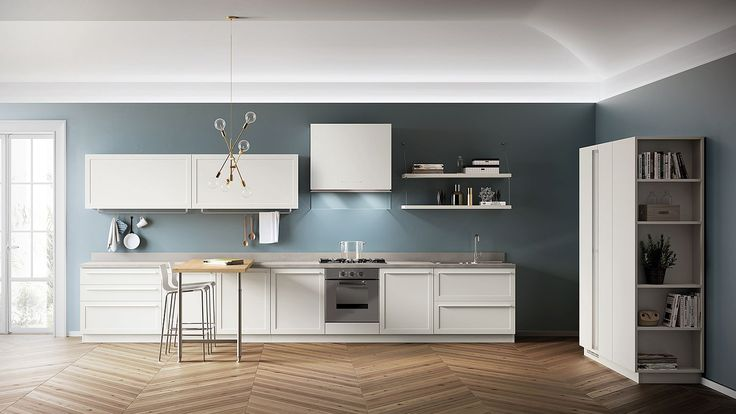 Blue brings an air of sophistication to the kitchen in white