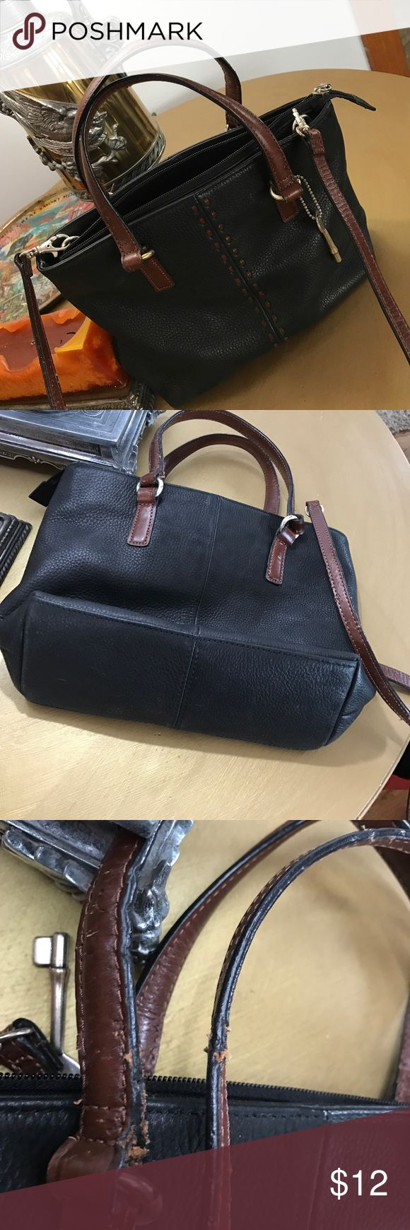 Fossil Bag Black leather with detach long strap. The bag is in great shape except the straps seem to have been teethed in perhaps ? Fossil Bags