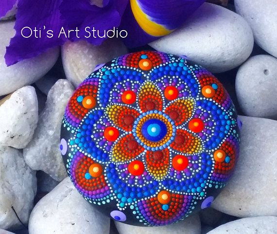 Mandala Stone- Hand Painted This precious stone was created with much love and joy. The mandala stones have in them many hours of joyful work and prayer for the owner to feel the vibration of joy, happiness and worth of our beautiful Universe. Size: 6cm.in diameter/ 2 1/2inch. I use