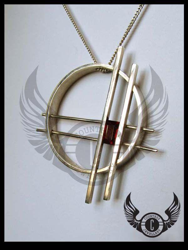 Custom design pendant set with a baguette Garnet