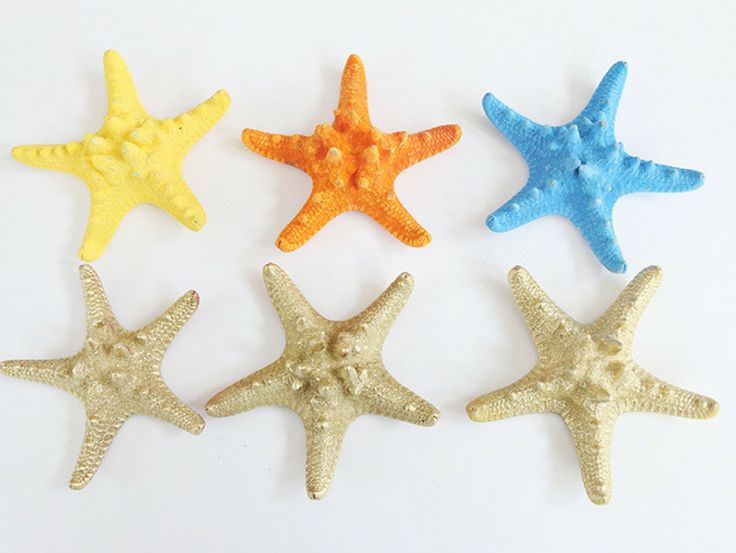 Add this DIY Starfish Garland to a beach inspired mantle or display at a beach party! Bring summer indoors with this pretty DIY starfish garland. I made this pretty white, gold and