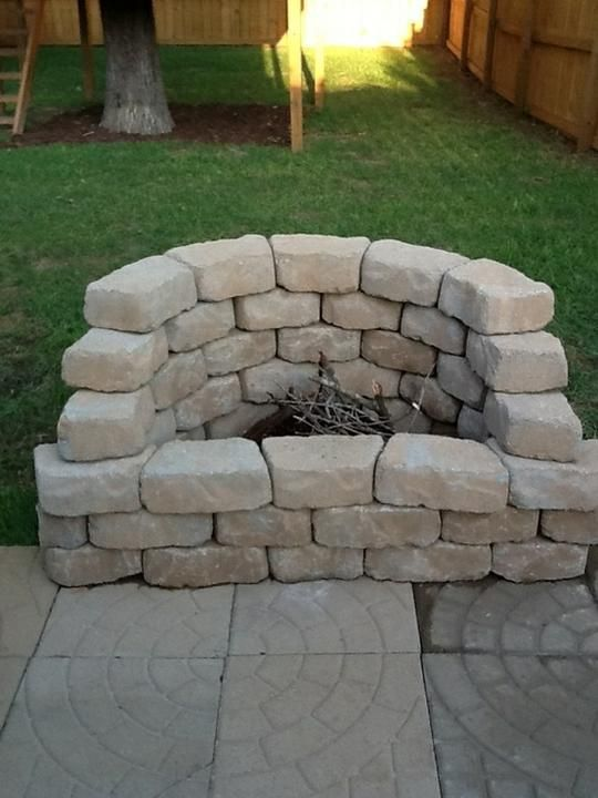 Half circle fire pit...good for small areas or just for the patio. Or a corner firepit if the patio is rectangular