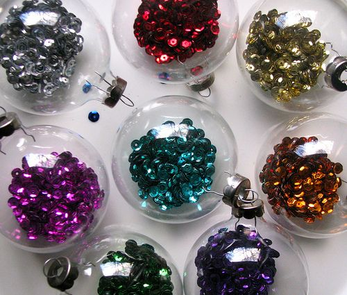 Clear ornaments filled with different colored sequins. Shiny!