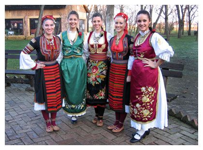 Woman in Serbian dress. I love the one in the middle.