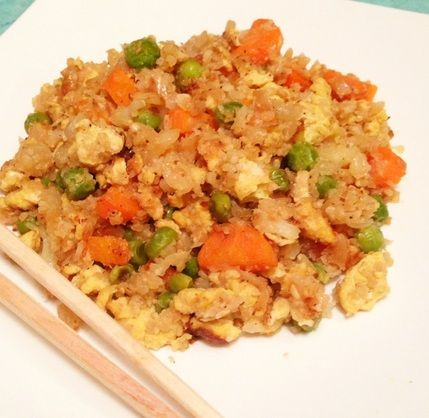 PALEO CAULIFLOWER FRIED RICE- Ingredients: - 1 head of cauliflower - 2 Tbsp. + 2 more Tbsp. lard/bacon fat or tallow - 4 carrots, peeled and chopped - 1 small onion, chopped - 2 Tbsp. garlic, chopped - 1 cup green peas - 4 eggs, whisked - 6 Tbsp. coconut aminos - 1/2 tsp. sesame oil - 1/2 tsp. fish sauce - Sea salt and ground pepper to taste