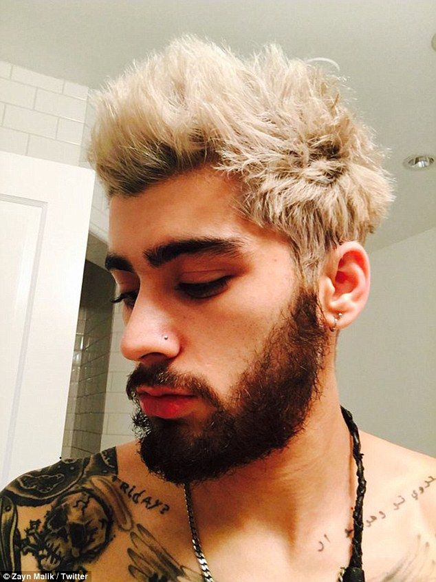 Like the do? Zayn Malik shared a shirtless selfie on his Twitter page on Thursday, where as well as displaying his impressive collection of tattoos he also debuted his new blonde locks