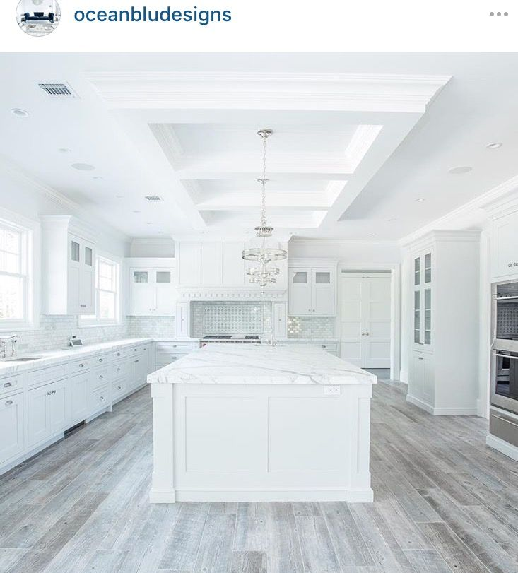 Grey floors in a white kitchen.