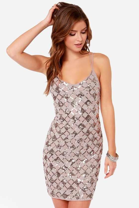 "The Dazzle and Amaze Beige Sequin Dress has got your style bases covered from A to Z! Twin sets of spaghetti straps emerge from a triangle neckline and crisscross a sultry open back. A woven poly bodice is covered in golden sequins and clear beads that sparkle in a magnificent diamond pattern that dazzles night or day. Hidden side zipper/clasp closure. Dress is fully lined. Model is 5'8"" and is wearing a size small. 100% Polyester. Hand Wash Cold."