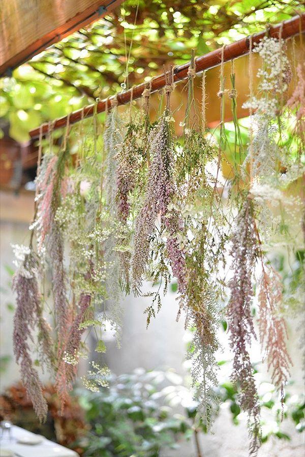 hanging greenery used as decor http://www.weddingchicks.com/2013/10/15/brooklyn-garden-wedding/