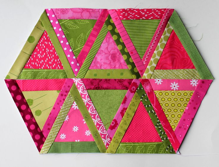 modern scrap triangle quilt blocks--60 degree triangles framed with 1 1/2 inch strips