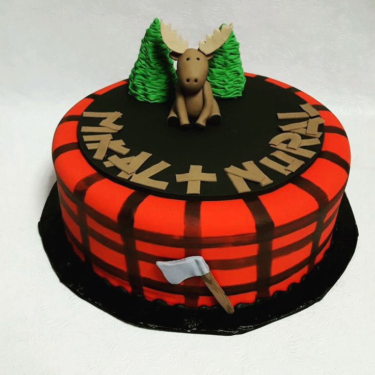 Lumberjack-inspired cake with an adorable moose fondant figure.  http://www.confectionperfectioncakes.com/childrens-birthday-cakes/