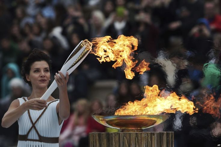 Octobeer 31, 2017:  Actress Katerina Lehou, playing the role of high priestess, lights an Olympic torch during a handover ceremony for the Olympic Flame at Panathenaic stadium in Athens, Greece.