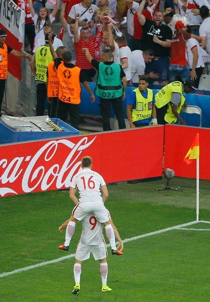 #EURO2016 Robert Lewandowski of Poland celebrates scoring a goal during the Euro 2016 quarterfinal football match between Poland and Portugal at the Stade...