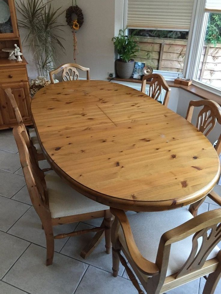 A solid DUCAL Victoria pine extendable oval dining table with 4 chairs plus two carvers. There are some minor wear and tear scratches to the table surface and to the chairs. | eBay!