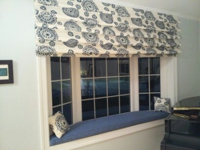 beautiful fabric with blue cruel embroidery on cotton add depth and texture to this charming bay window seat a hobbled valance and matching pillows top off