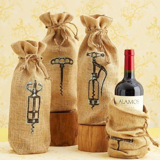 Rustic Corkscrew Bags ~ We'll drink to these charmingly rustic gift bags, each branded with a different antique corkscrew design. Make them a gift on their own, or use each bag to wrap a wine bottle for your hostess. Print an antique corkscrew picture on iron-on transfer paper. Follow directions to transfer the picture to a jute or burlap bag. Tie the bag closed with twine.