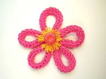 Spool knitting for kids. Knit up some cord on your knitting spool (or double-pointed needles) and make this sweet flower pin.