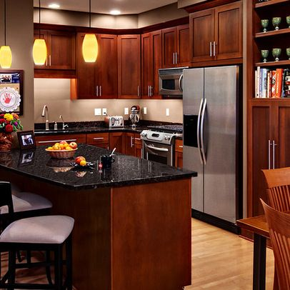 cherry kitchen cabinets with gray wall and quartz countertops ideas - Cabinet Design Ideas
