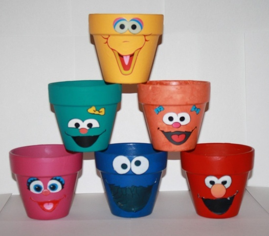 Sesame Street Terra Cotta Pots __ (my children & grandchildren are too old for these but had to pin as I thought they were too cute not to )