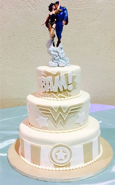 Their cake was awesome tho! #weddingday #superman #wonderwoman…