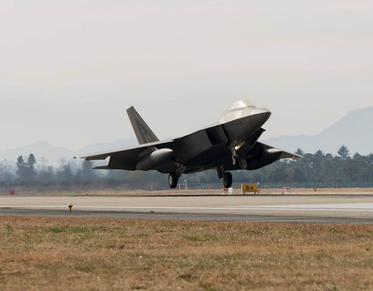 US Air Force F-22 Raptor fighter jet touching down at Gwangju Air Base