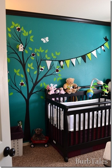 Teal nursery. Tree wall decal, bunting flags on the wall. So cute! LOVE THE COLORS!