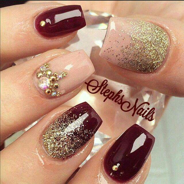 Dark red with gold glitter and gems! Beautiful design