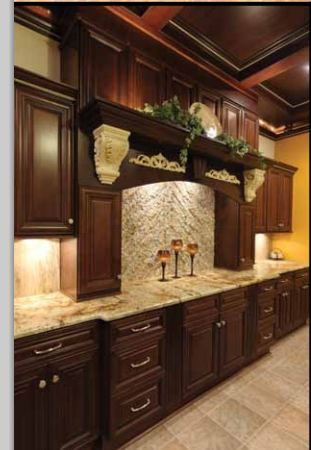 Bristol chocolate cabinets - like the light counters and dark cabinets....GOLD wall