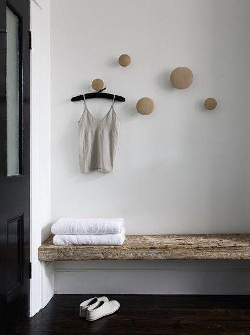 Dark floors, white walls, black door, rustic bench. The Design Chaser: Interior Styling | Rustic Bathrooms